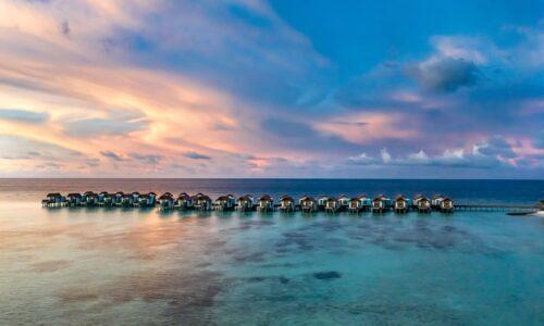 HRHM-Aerial-Sunset-OverWaterVillas-scaled-500x300.jpg