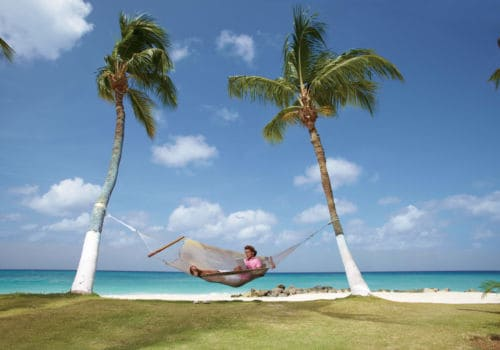 Man relaxing in hammock in Aruba