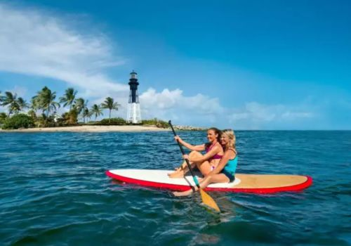 Lesbians paddleboarding in Fort Lauderdale