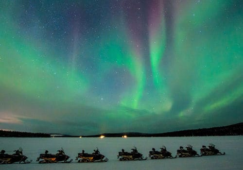 Northern Lights snowmobiling tour in Lapland